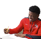 Student in track jacket studying